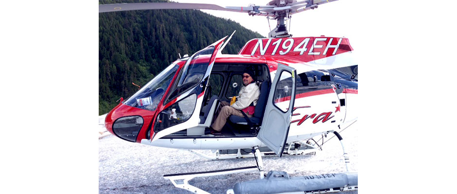 Dan explores a glacier by helicopter during his trip to Alaska